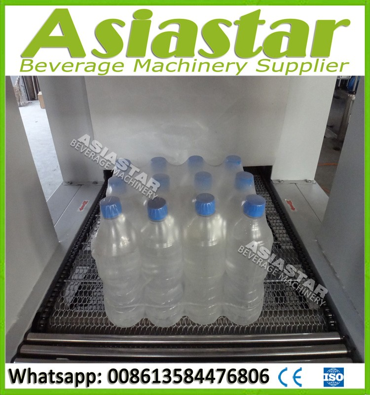 Semi automatic plastic label insert and shrink machine