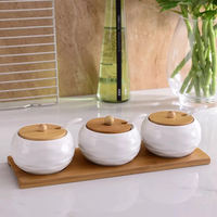 Set of three white porcelain spice condiment pot with bamboo cover tray for kitchen