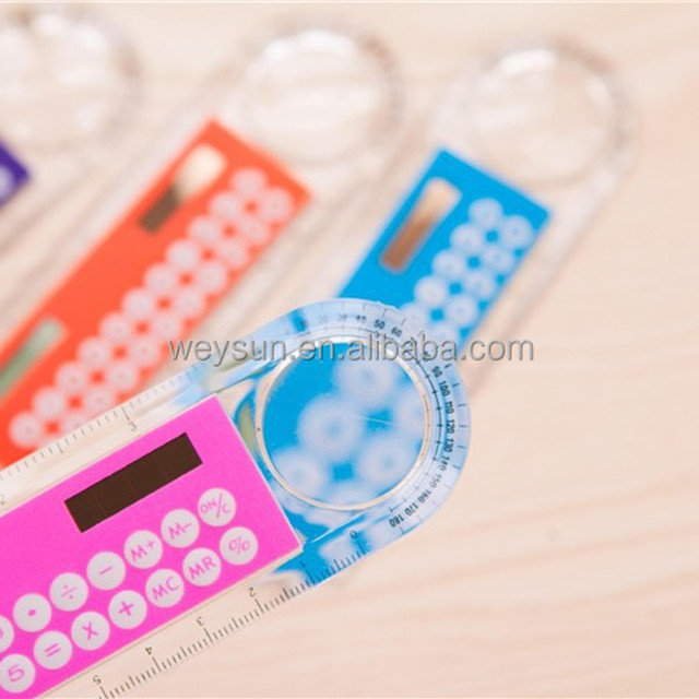 Plastic straight ruler with calculator and magnufying lense