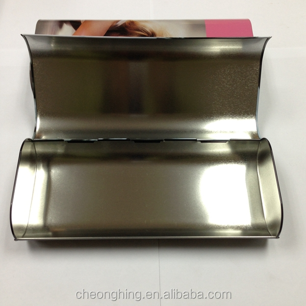 large empty hinged rectangular tin cans