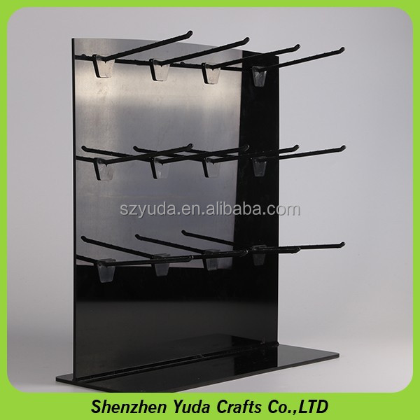 Black acrylic countertop display attached with J hooks peg display stand