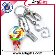 Best quality metal hollow out cross and bell meal keychains for gifts