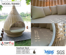 Attractive man-made wicker furniture nestrest pod for dedon.