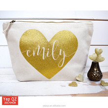 China manufacturer natural color canvas wedding bag recycled cosmetic makeup case with shiny heart gold logo printing