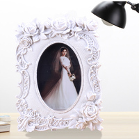 2015 Factory Direct Selling Big flower decoration hot sexy photo frame acrylic European style polyresin art picture frame BY001