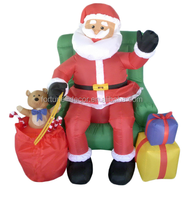 150cm/5ft inflatable santa claus waving and shaking his hands on the chair with two gift bags and a beer