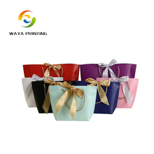 CMYK printed logo ribbon paper shopping bag, collapsible shopping bag with bowknot