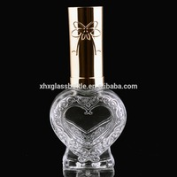 Luxury Fancy Unique 15Ml New Design Heart Shape Nail Polish Glass Bottle With Shiny Cap With Bow Knot Pattern