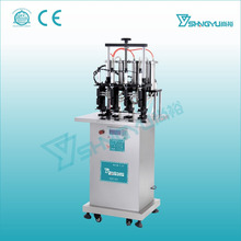 Semi automatic vaccum perfume glass bottle filling machine with 4 heads from factory