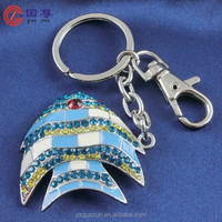 Metal blue fish with small crystals on it and red eye key chain/key ring