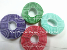 Reusable back to back hook and loop fastener tape roll for chair