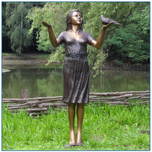 Outdoor life size bronze girl with bird sculpture for garden decoration