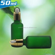 frosted green glass dropper bottle