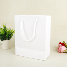 ECO packaging PP cord handle brown kraft paper bag manufacturers