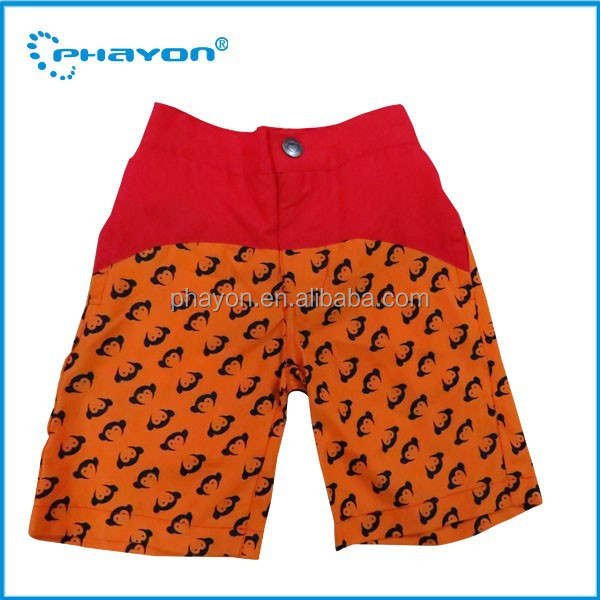 casual printing children swim shorts,boys in swimming trunks photo