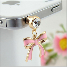 Newest style fashion wholesale gold plated metal bowknot dust plugs for mobile phone