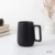 Customized logo creativity cheap plain black matte porcelain coffee mug promotion ceramic coffee cup and mug with spoon