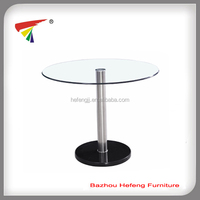 Black base clear glass top dining table
