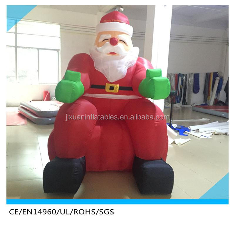 outdoor inflatable santa in chair,inflatable santa sit chair for photo