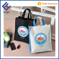 China factory cheap eco friendly tote bags wholesale, strong cross stitched handle custom reusable shopping bag non woven