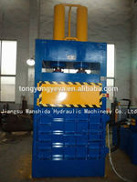 Vertical tire/cardboard/textile etc compactor with UK design and CE