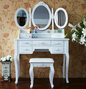 White dressing table with many drawers