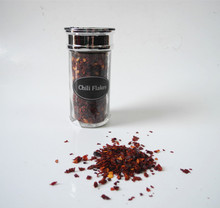 spice and herbs red pepper paprika crushed chili in glass bottles