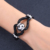 Fashion handmade good luck charm jewelry stainless steel jewelry braided black leather bracelet