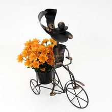 Garden ornaments metal dog by bike animal planter
