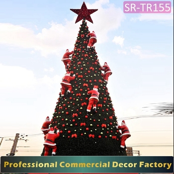 giant outdoor christmas tree with climbing santas decoration