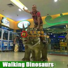 Kiddie animatronic walking dinosaur rides