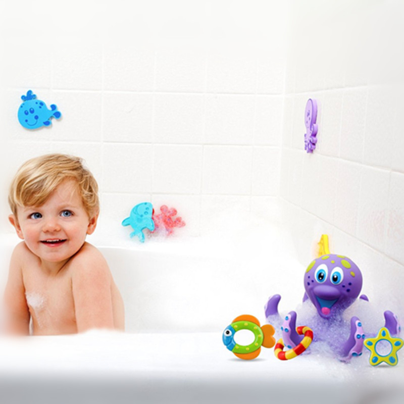 mini plastic purple Octopus and three Hula Hoops for baby bath time fun