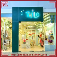Green baby clothes retail store interior and exterior design