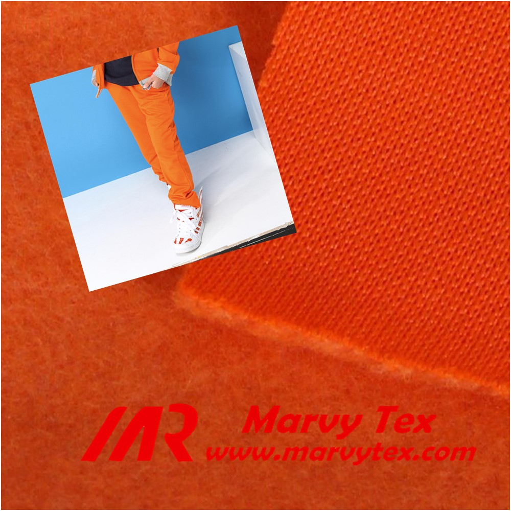 warp knitting polyester french terry fabric for orange pants export to Jordan
