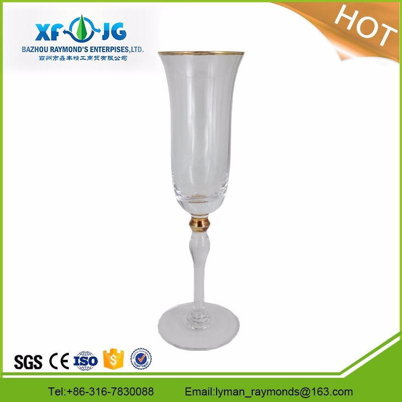 Transparent champagne flute with golden decoration