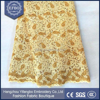 Alibaba latest hot selling lace dress plus size / gold colour guipure lace fabrics new sample