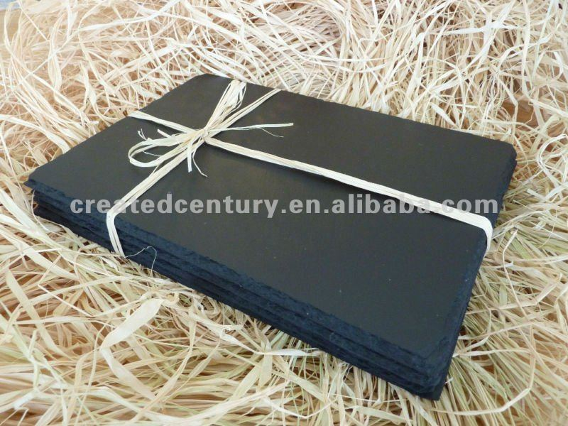 Natural black slate serving plate with raphia bow