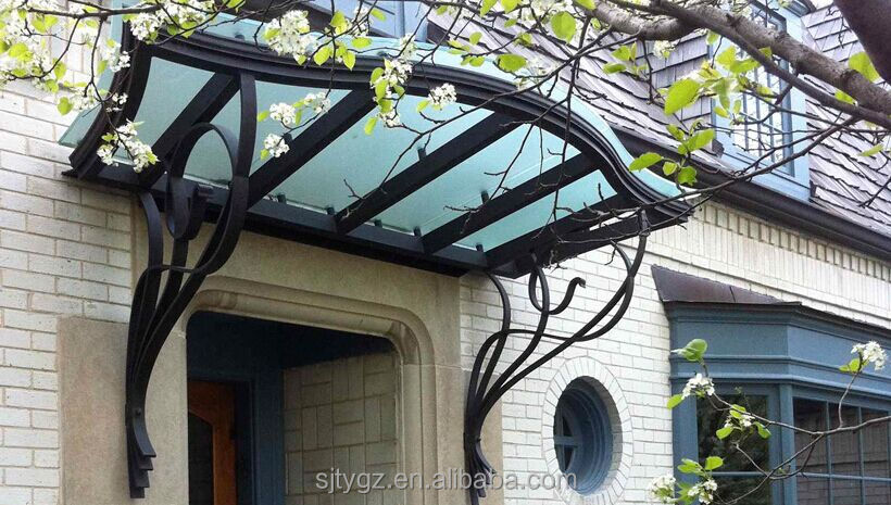 Wrought iron eyebrow awning with decorative scrollwork