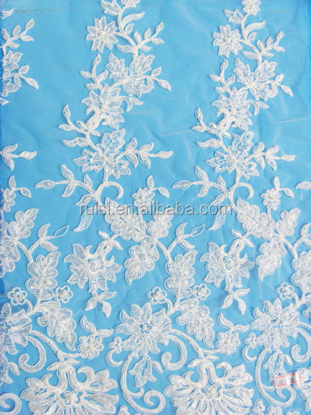 Fully embroidered motifs on soft tulle for wedding gowns or special occasions