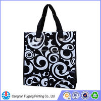 Recycled PP woven bag with metal eyelet