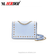 Online shop China low MOQ light blue leather handbag with metal strap and eyelet fashion women leather bag