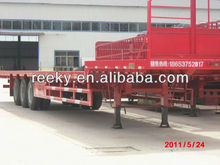 tri-axle low-bed cargo type semi-trailer for transporting heavy machinery