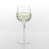 Clear wine glass with colored swirl