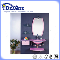 Table top glass wash basin with pink painted with tap with mirror with frame