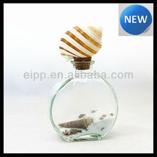 White Sea Sand And Seashell Inside Glass Bottle With Cork