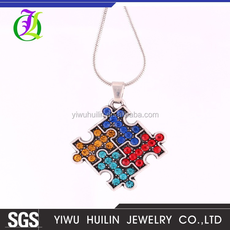 A500106-1 Yiwu Huilin Jewelry puzzle <strong>1000</strong> piece pendant necklace alloy autism indian jewelry