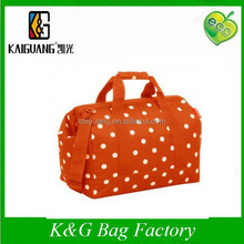 Orange dots 600D polyester travel luggage bag, Professional China Bag Factory