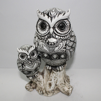 TV cabinet DecorBlack and white owls stand on stumps ornaments