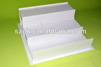 white acrylic stair step displayer