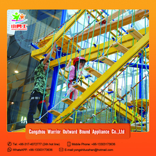 Indoor adventure park with artificial rock climbing wall for kids